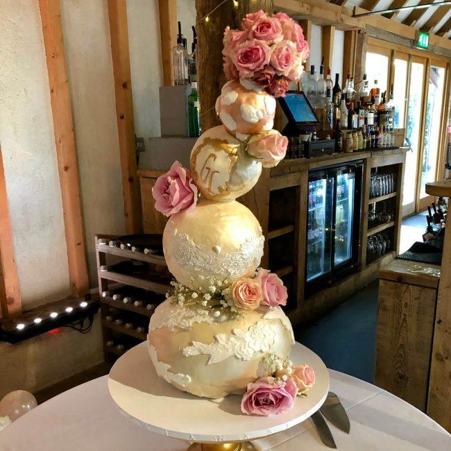 Liz and Guy's Fabulous wedding cake in the main barn